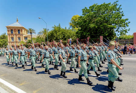 Seville, Spain - June 01, 2019: Spanish Legion (Spain's Rapid Reaction Force) during display of Spanish Armed Forces Day in Seville, Spain 報道画像