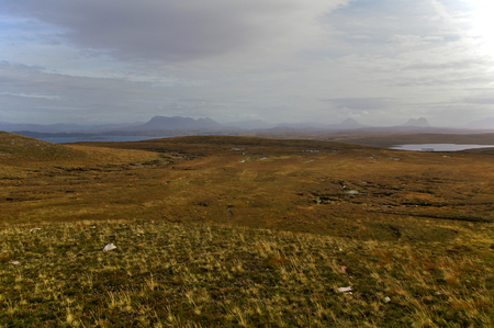 Vast expanse of moorland with mountain range in the distance near Point Of Stoer, Assynt, Sutherland, Scotland