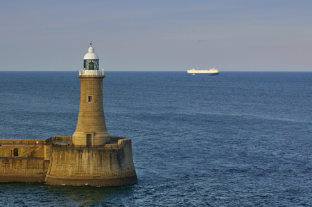 Lighthouse at the end of the breakwater in the Tyne estuary