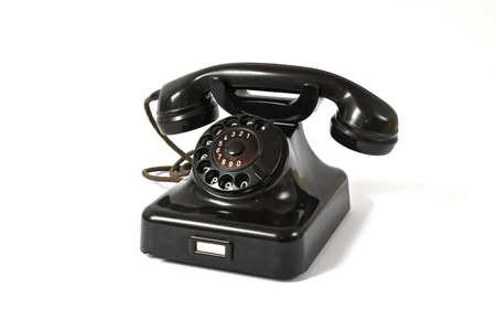 caller: Old black rotary dial telephone Stock Photo