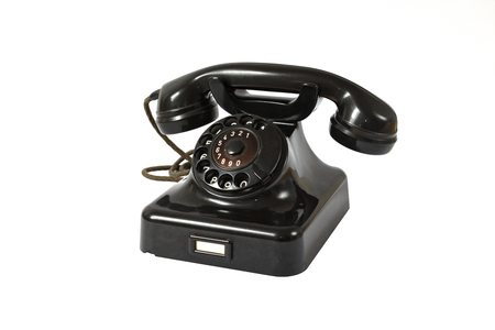 Old black rotary dial telephone Stock Photo