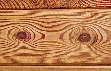 Wooden board with distinctive grain and two big gnarls Stock Photo