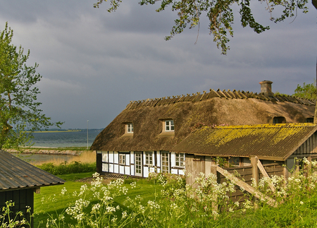 Lyo, Denmark - July 4th, 2012 - Traditional timber-framed thatched Danish farmhouse on the island of Lyo in the Baltic