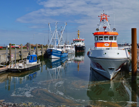 Amrum, Germany - May 27th, 2016 - Harbor on the island of Amrum with fishing boats and life boat at their moorings