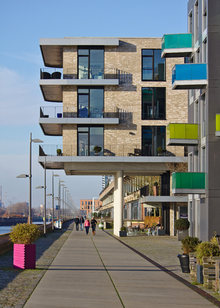 Bremen, Germany - November 25th, 2017 - Modern residential building above the esplanade at the Europa harbor in the Überseestadt district with all-round balconies Sajtókép