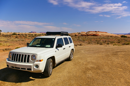 White SUV on a remote desert trail