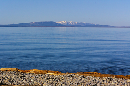 View across Yellowstone Lake in the early morning, Yellowstone National Park, USA Фото со стока
