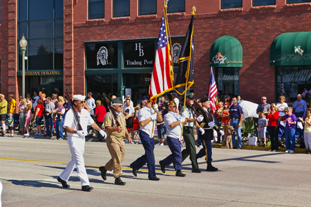 Cody, Wyoming, USA - July 4th, 2009 - Veterans of the different branches of the armed forces marching with the Independence Day Parade