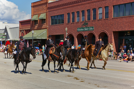 Cody, Wyoming, USA - July 4th, 2009 - Four riders dressed in black depicting Wyatt Earp, Virgil Earp, Morgan Earp and Doc Holliday participate in the Independence Day Parade