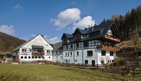 Willingen, Germany - March 27th, 2018 - Traditional timber-framed and whitewashed farm building