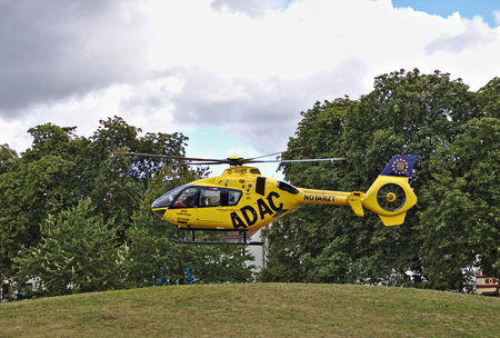 Bremen, Germany - July 10th, 2018 - Emergency rescue helicopter taking off in a park