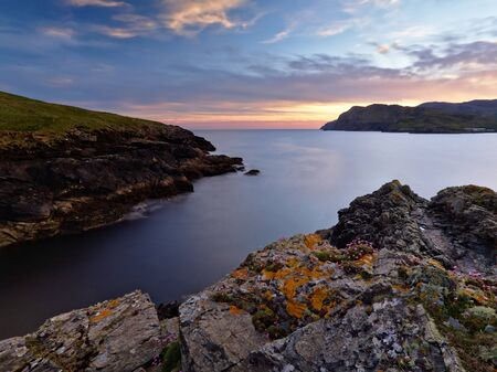 The rocky shores of Tawny Bay, Co. Donegal on the Irish west coast at sunset.