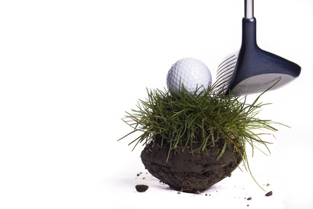 clod: Golfing On Clod Of Grass Against White Background Stock Photo