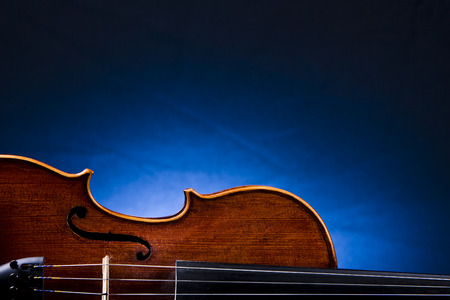 Violin In Front Of Blue Background