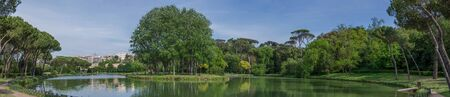 panoramas: Eur area park outdoor lake, a big green park bihind the city center. A green meadow for relax time in Rome