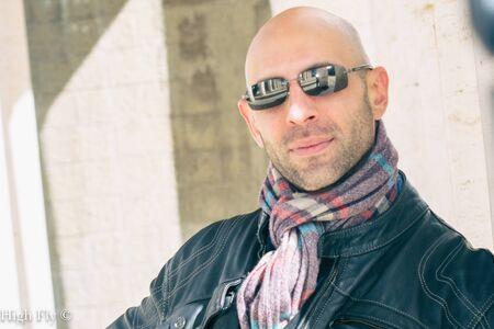 fashion man portrait on white colomns frame