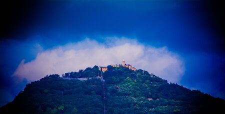 lodger: a holy mountain in Italy, a monastery standing over the clouds,forests, colored picture, nature portraits