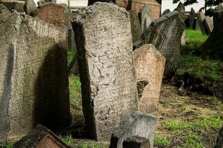 The very old jewish cemetery with a lot of shabby stone tombstones.