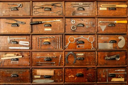 A detail of an old cupboard with drawers, part of the old vintage ironmongery.