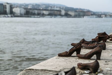 A memorial remembering the murder of the Jews during second world war. Standing by the river Danube in Budapest.