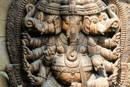 The detail of the wooden statue of Ganesha, one of the indian Gods in a public park.