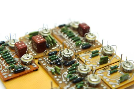 The old vintage circuit board with several electronic components. Stock fotó