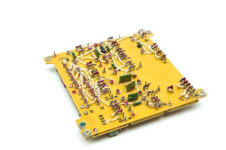 The old vintage circuit board with several electronic components. Reklamní fotografie