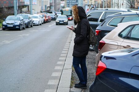 Illustration of the problem of the modern age. Called digital zombie. People are watching their smart phone with hood and headphones and don´t pay attention