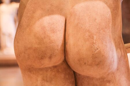 A detail Picture of the antique statue´s bottom. Hard and sculptural. Reklamní fotografie