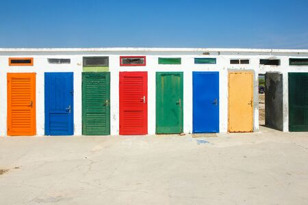 The colorful doors of one of the old changing rooms or cabins at a beach in Croatia.