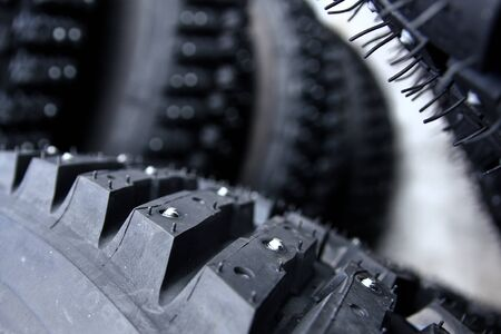 A detail of the tyre with studs used for the rally cars to have a better control on snow and ice. Reklamní fotografie