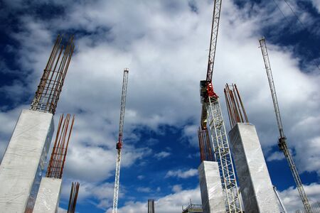 A picture of the large construction site with cranes.