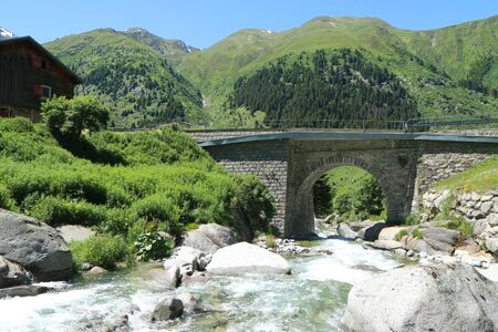 Beautiful Swiss nature pictured during the nice summer day. The sky is blue, nature green and the landscape is great.