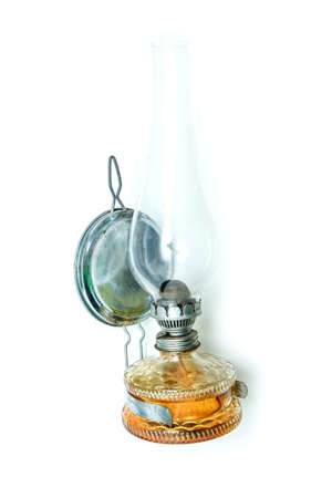 The traditional old retro or vintage petroleum lamp isolated in a white background.