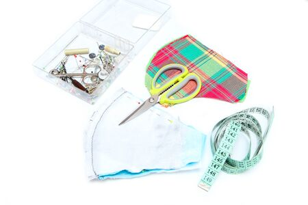 The picture shows the equipment needed for home sewing of the textile masks for protection against transfer of the viruses like coronavirus. Initiative of the people because of a lack of aids.