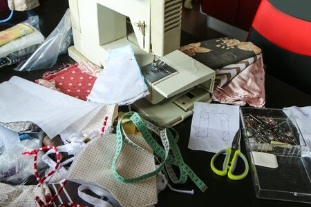 The picture shows the equipment needed for home sewing of the textile masks for protection against transfer of the viruses like coronavirus. Initiative of hte people because of a lack of aids.