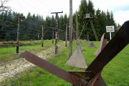 """The monument dedicated to those, who wanted to leave soviet block towards capitalist countries. Part of the fence on borders with barbed wires. The sign says """"Attention, forbidden area, no entry!""""."""