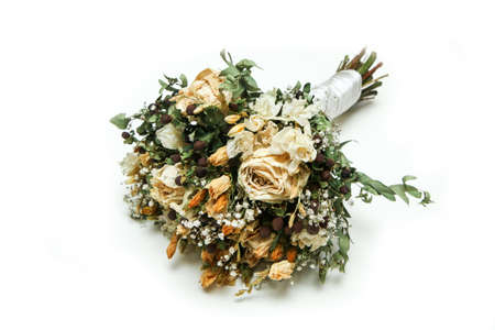 The dried wedding bouquet of roses and other flowers. A saved memory for a marriage.
