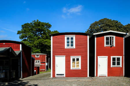 Several nice tiny wooden falun red houses for the fishermen in Swedish city of Malmö. Nice sight for the tourists. 免版税图像