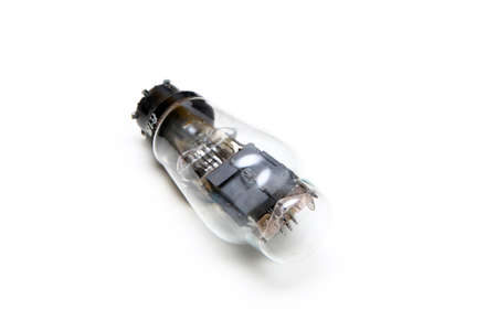 The single vacuum or electron tube isolated on a white background. The obsolete electronic device for current control.