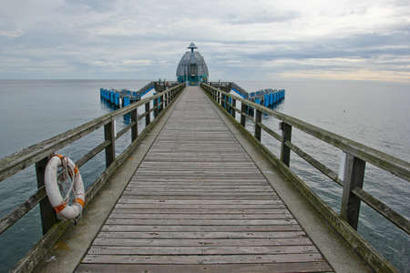 A pier standing alone in the north sea at Binz in Germany. 免版税图像