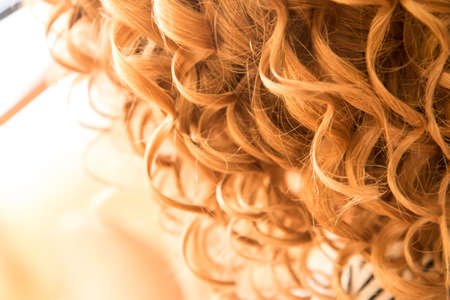 The detail of the curly hair of the woman. She is a bride and is prepared for the ceremonial.