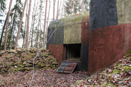 A picture of an old concrete pillbox from czech fortification. Never used for battle.