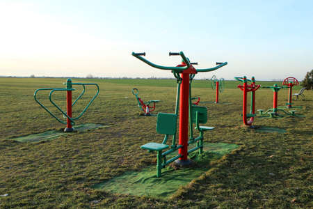 The public fitness area or playground for adults and children. They can do excersices outside on fresh air. 免版税图像