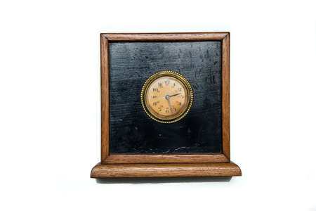 The antique wooden clock isolated on a white background.