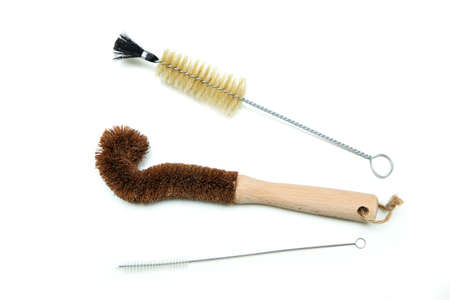 The cleaning brushes for bottles, one is made from wood and natural bristles, two are made of metal. Isolated on a white background. 免版税图像