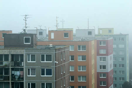 The misty morning detail of the part of the big area of high rise block of flats from the socialist era in Prague in Czech Republic called Černý most. Like rabbit hutches fot the people.