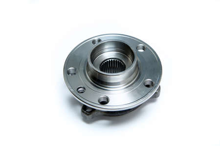 The new car wheel bearing isolated on a white background. Spare part to replace the old one. Foto de archivo