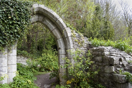 ruins is ancient: ancient English arch in a park