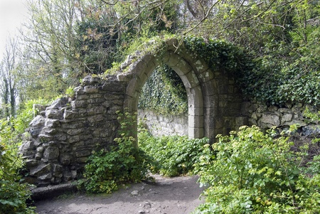 old arch in a park photo